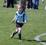 Granddaughter playing soccer (football)