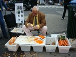Selling peelers on the market in Place, New York