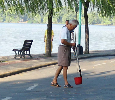 Writing Chinese characters in water at Westlake, Hangzhou, China