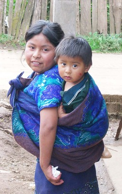 Older female siblings caring for younger children in the family, Chiapis, Mexico.