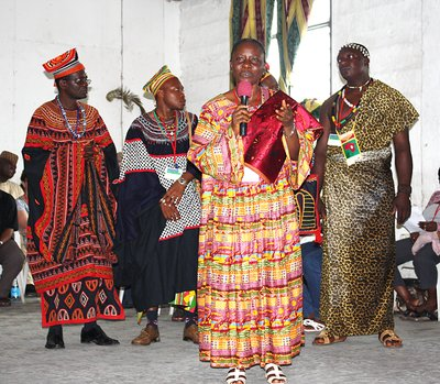 Closing ceremony of the IACCP 4th Africa Region Conference, Cameroon, West Africa.  Four graduate students demonstrating formal native costumes of various West African tribes.