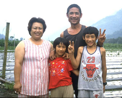 "A family of the Bunong tribe, central Taiwan. The Bunong are an aboriginal tribe that predate the arrival of ethnic Chinese people to Taiwan.  Here shown displaying the universal symbol for ""hello."""