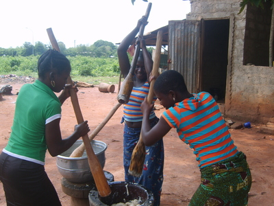 Women Meshing Yam for Lunch in Abomey-Calavi, Benin