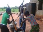 Women Meshing Yam for Lunch in Abomey-Calavi, Benin