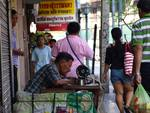 Tailor at Work on the Streets of Bangkok by Viviana Geana