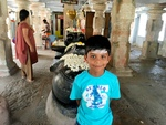 A 7-year old boy at a temple in South India (near Hyderabad) by Nicole Summers