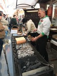 Making chimney cakes (Kürtőskalács)